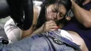 imagen Estacionamiento y una latina tragándose una polla
